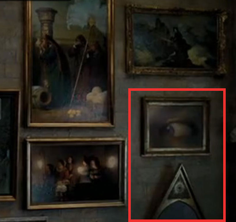 All-Seeing Eye and pyramid hidden among the many framed paintings which adorn the walls of Hogwarts School of Magic.