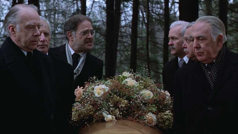 Pallbearers discussing how to retain the next presidency
